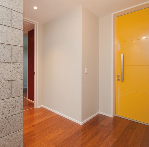 Lone Pine Building - Hallway with yellow door and wooden floors